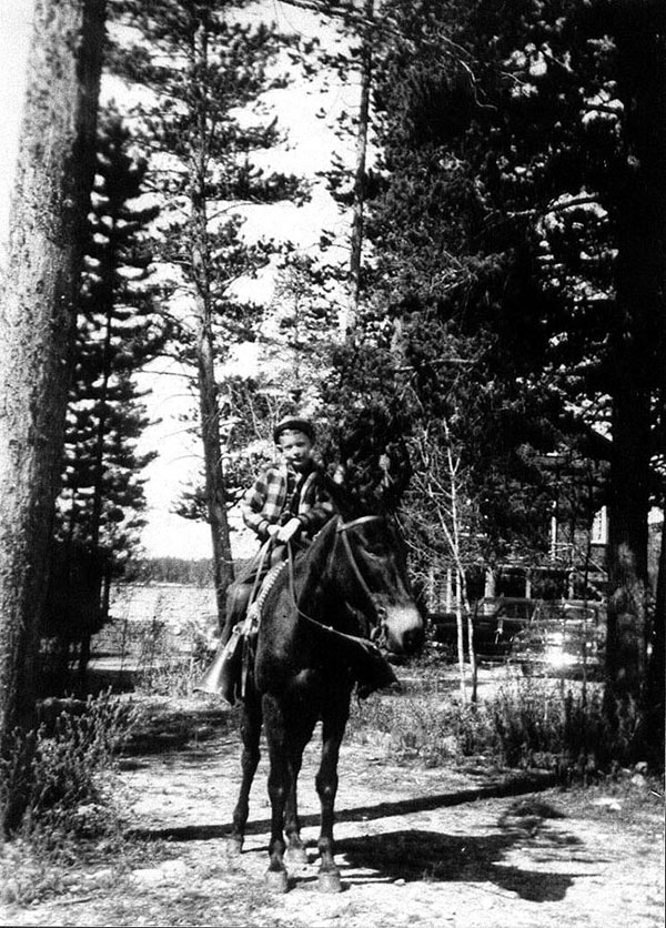 Jim at 7 on a mule