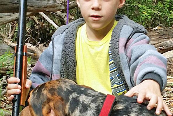 boy shot gun dog